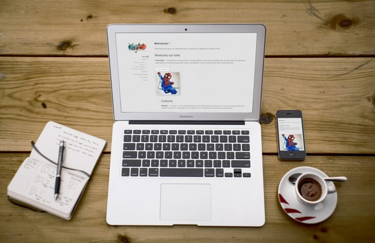 Key-ArT website on a laptop and a smartphone